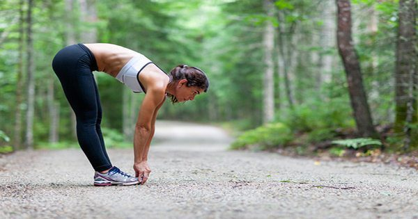 blog picture of lady stretching on running trail