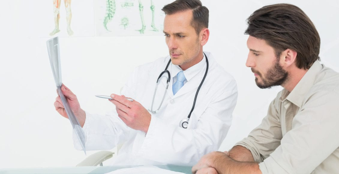doctor explaining spine ray to patient