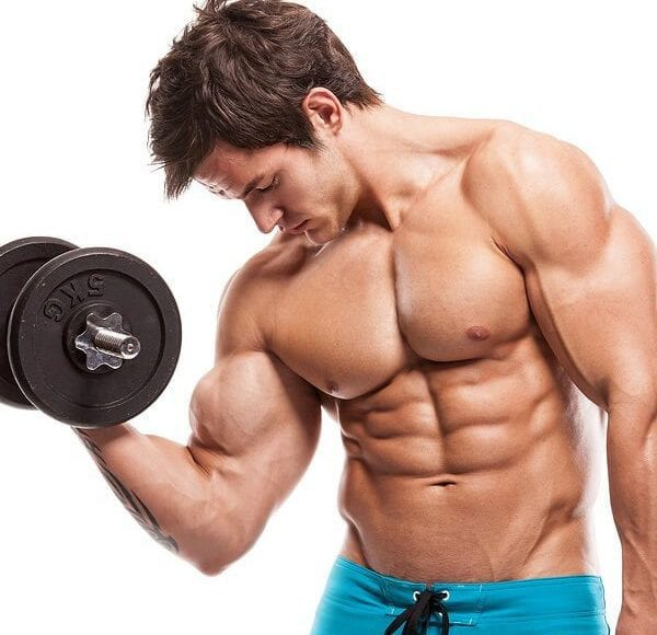 young man doing arm curls no shirt all muscles