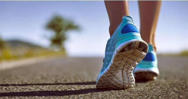blog picture of runners shoes on pavement