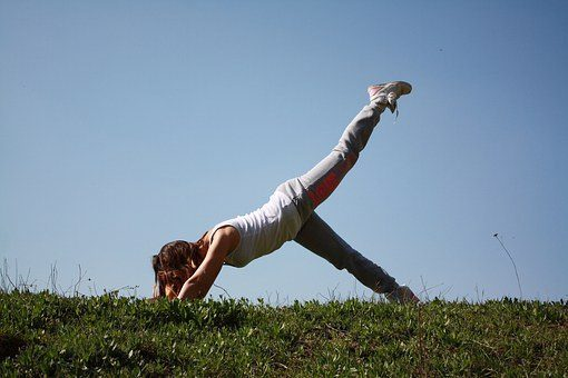 blog picture of lady doing pilates for back pain