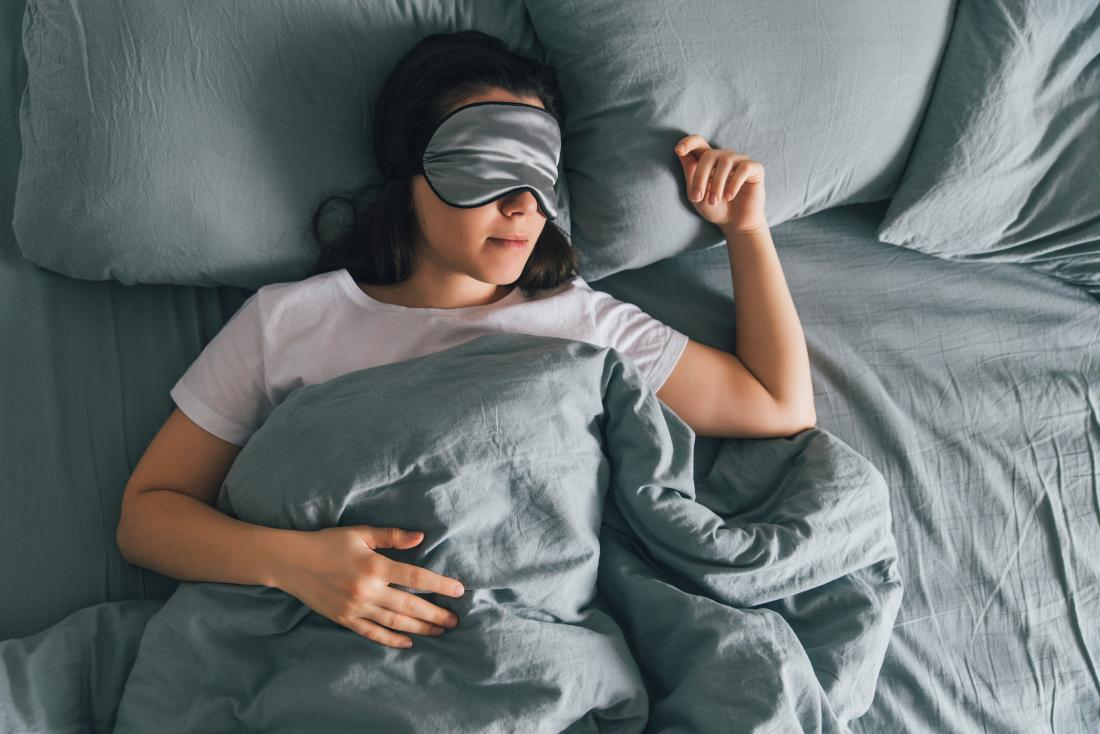 person-sleeping-in-bed-with-eye-mask-on
