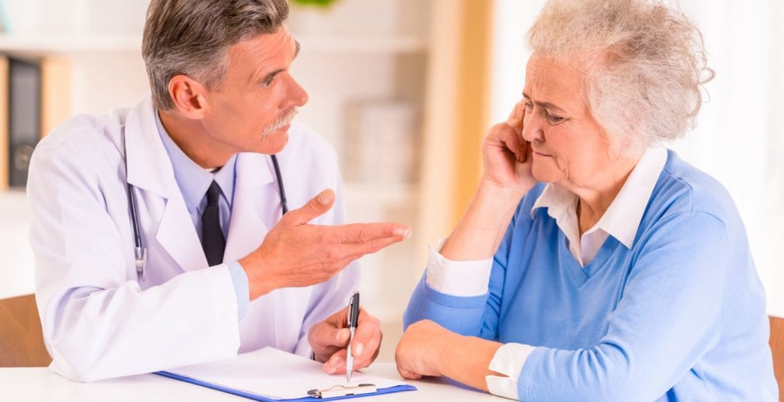 Image of a doctor discussing the gut-brain connection in older patient with Parkinson's disease.